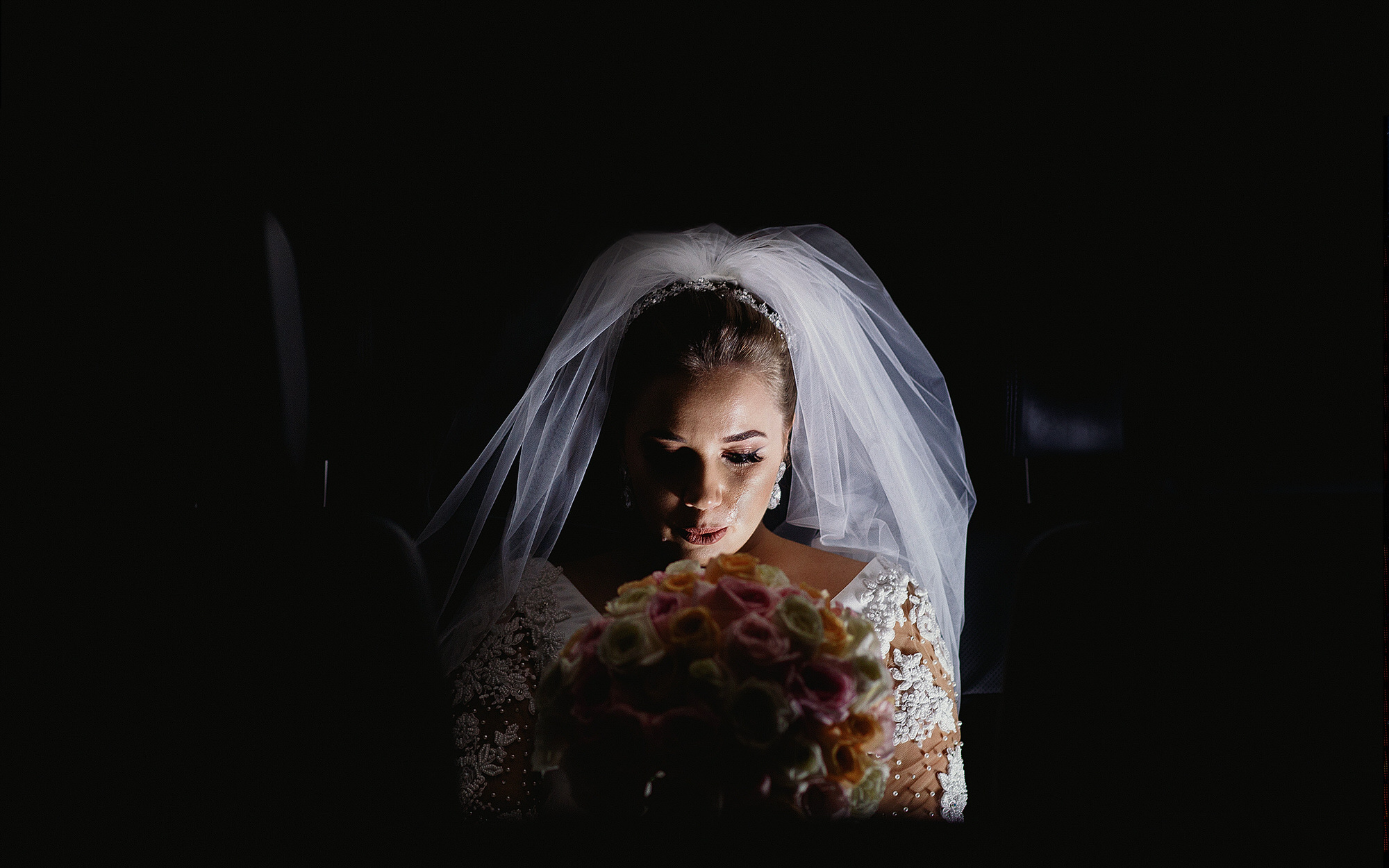 Bride cries in a beautiful and touching wedding photography